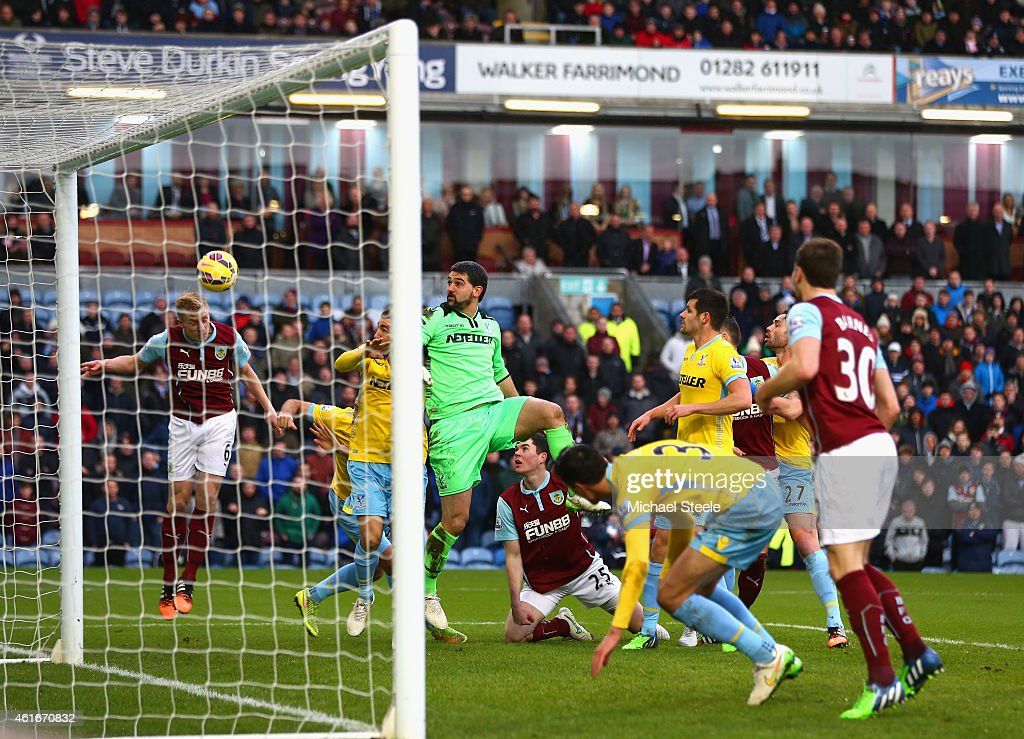 Ben Mee of Burnley heads in the opening goal during the Barclays Premier League match between Burnley and Crystal Palace at Turf Moor on January 17...