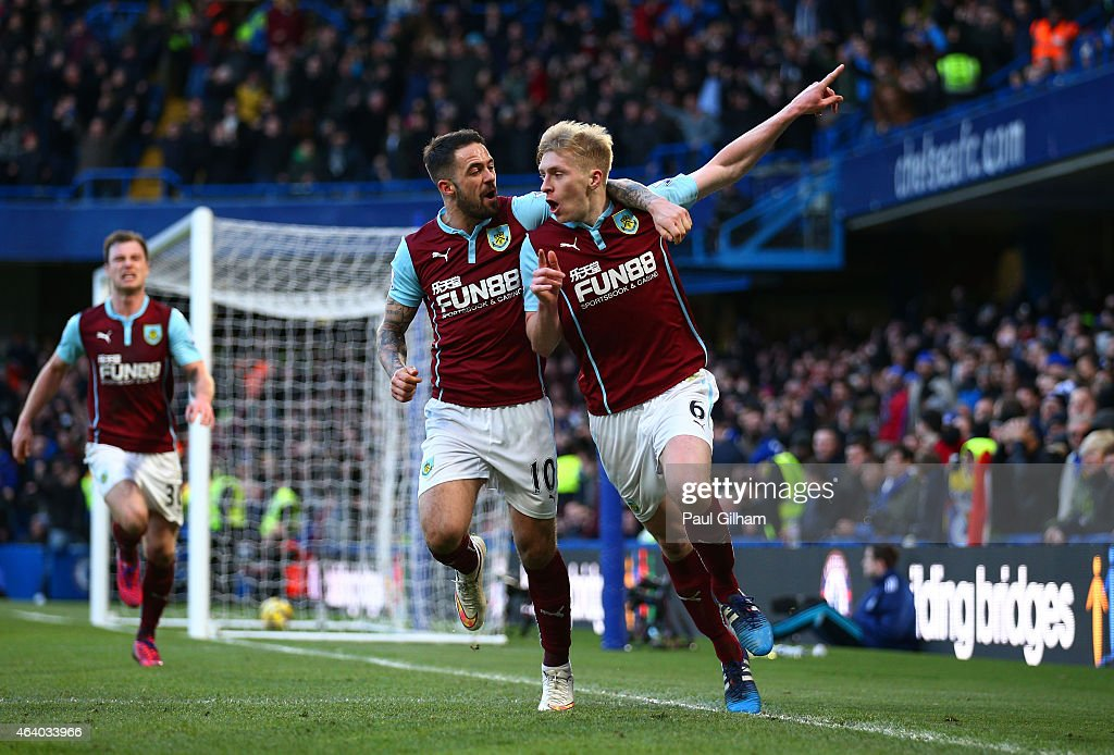 Ben Mee (R) of Burnley is congratulated by teamate Danny Ings of Burnley after scoring a goal to level the scores at 1-1 during the Barclays Premier League match between Chelsea and Burnley at Stamford Bridge on February 21, 2015 in London, England.