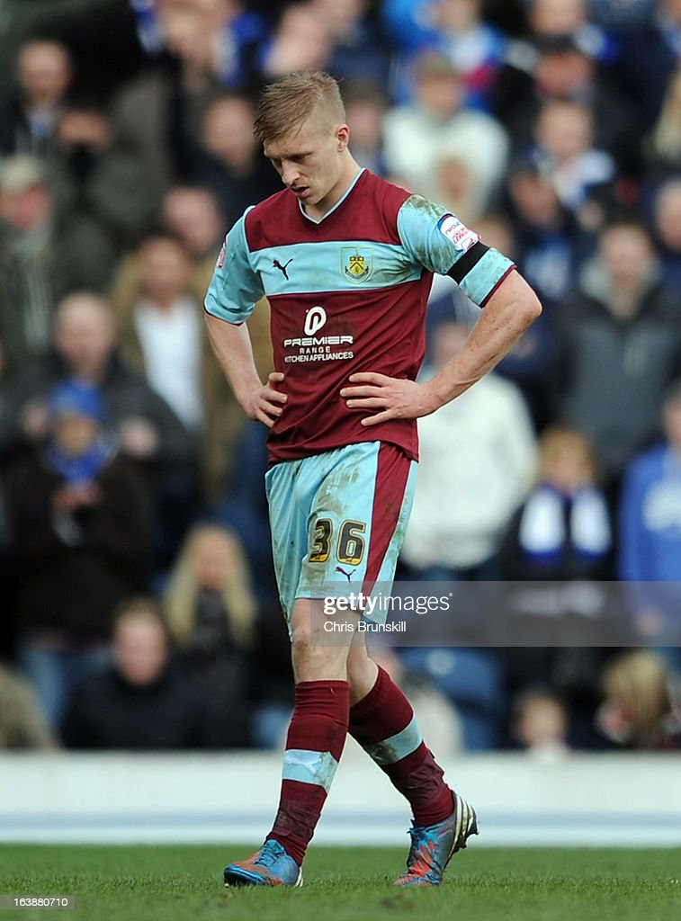 Ben Mee of Burnley leaves the field after being sent-off during the npower Championship match between Blackburn Rovers and Burnley at Ewood park on March 17, 2013 in Blackburn, England.