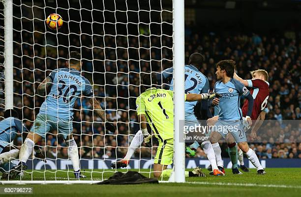 Ben Mee of Burnley scores his sides first goal during the Premier League match between Manchester City and Burnley at Etihad Stadium on January 2...