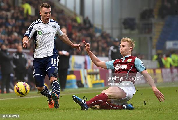 Ben Mee of Burnley tackles Callum McManaman of West Brom during the Barclays Premier League match between Burnley and West Bromwich Albion at Turf...