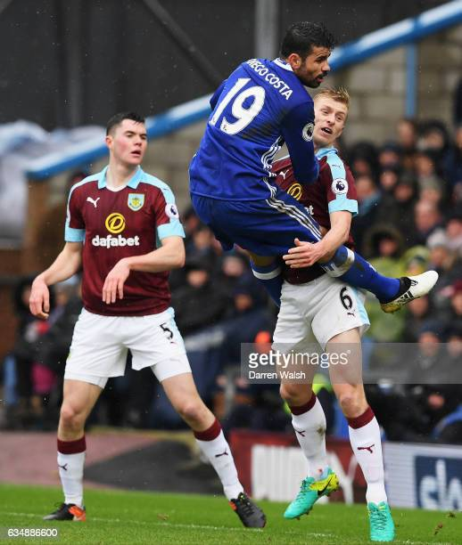 Ben Mee of Burnley tangles with Diego Costa of Chelsea during the Premier League match between Burnley and Chelsea at Turf Moor on February 12 2017...