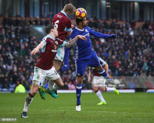 Ben Mee of Burnley wins a header against Diego Costa of Chelsea during the Premier League match between Burnley and Chelsea at Turf Moor on February...