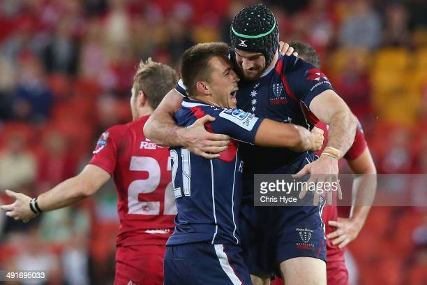 Ben Meehan and Hugh Pyle of the Rebels celebrate winning the round 14 Super Rugby match between the Reds and the Rebels at Suncorp Stadium on May 17...