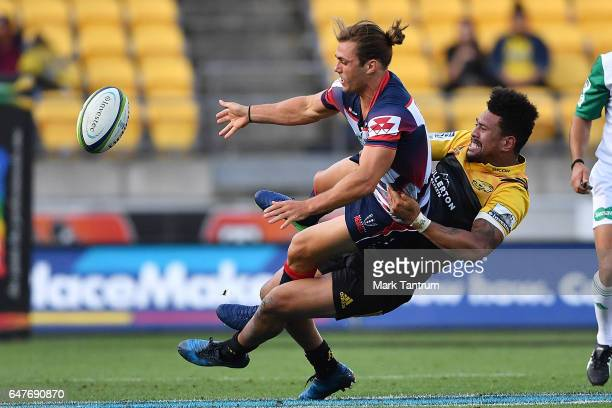 Ben Meehan of the Melbourne Rebels and Ardie Savea of the Hurricanes during the round two Super Rugby match between the Hurricanes and the Rebels at...