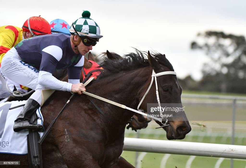 Ben Melham riding Eurack turns into the home straight before winning Race 6 during Melbourne Racing at Sandown Hillside on August 23, 2017 in Melbourne, Australia.