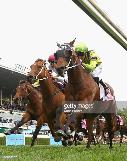 Ben Melham riding Thermal Current crosses the line to win the Telstra Phonewords Stakes during Cox Plate Day at Moonee Valley Racecourse on October...