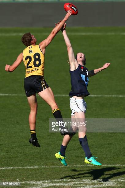 Ben Miller of Western Australia wins a ruck contest against Sam Hayes of Vic Metro during the U18 Championships match between Western Australia and...