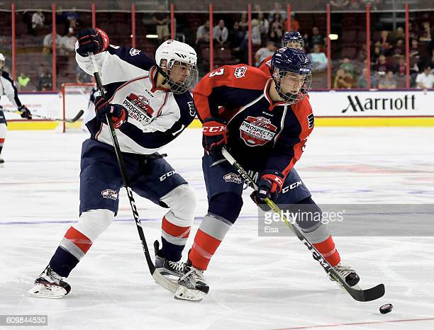 Ben Mirageas of Team Howe tries to keep the puck from Ryan Poehling of Team LeClair during the CCM/USA Hockey AllAmerican Prospects Game on September...