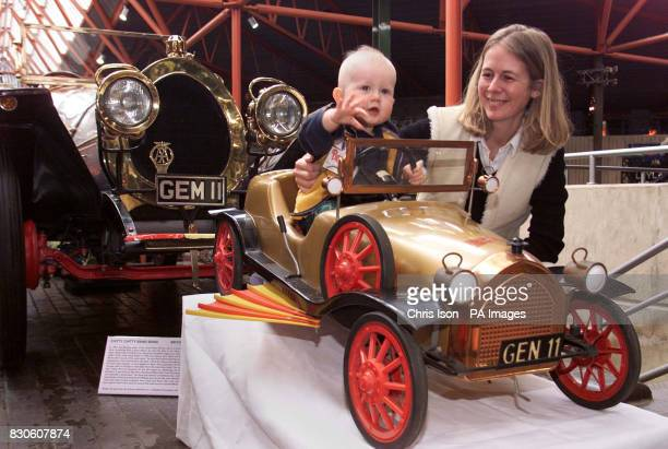 Ben Montagu Scott the 10 month old grandson of Lord Montagu of Beaulieu and his mother Mary while officially opening the Motoring Thru Childhood...