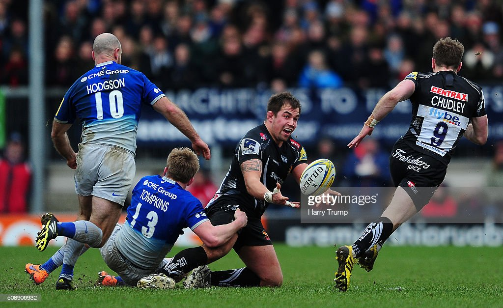 Ben Moon of Exeter Chiefs is tackled by Nick Tomkins of Saracens during the Aviva Premiership match between Exeter Chiefs and Saracens at Sandy Park on February 7, 2016 in Exeter, England.