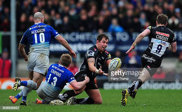 Ben Moon of Exeter Chiefs is tackled by Nick Tomkins of Saracens during the Aviva Premiership match between Exeter Chiefs and Saracens at Sandy Park...