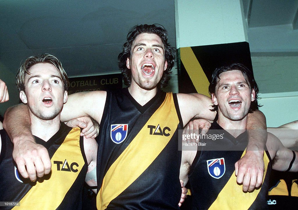 Ben Moore, Matthew Richardson and Nick Daffy of Richmond celebrate in the rooms after their win, in the match between Richmond and North Melbourne, during round 20 of the AFL season, played at the Melbourne Cricket Ground, Melbourne, Australia. Mandatory Credit: Hamish Blair/ALLSPORT