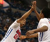 Ben Moore of the Southern Methodist Mustangs celebrates with teammates after defeating the Temple Owls in a semifinal game of the American 2015...