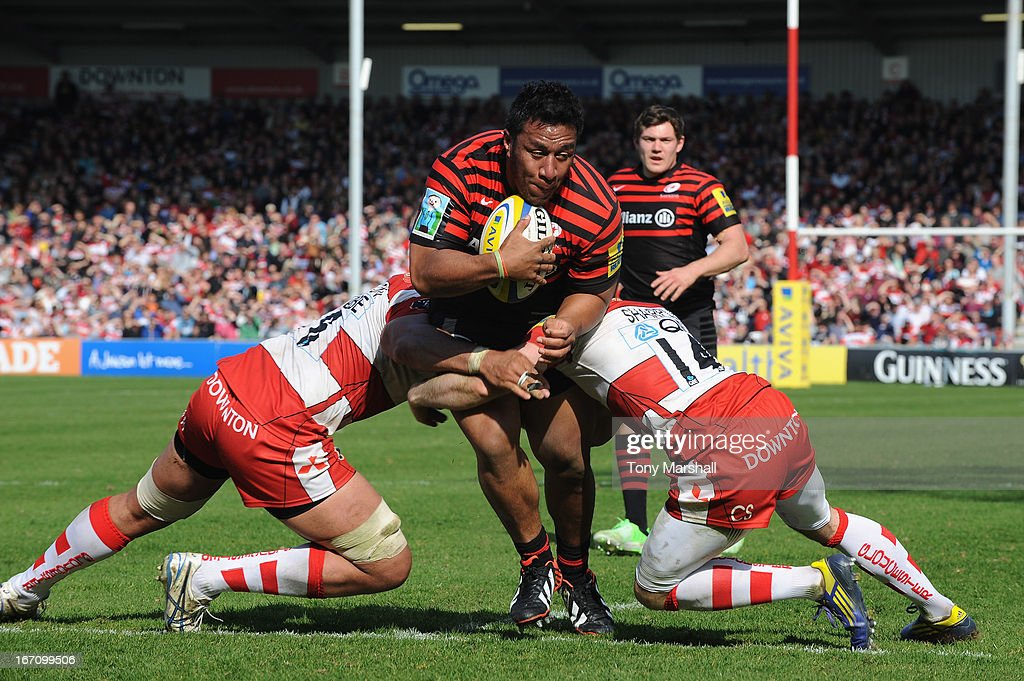 Ben Morgan (left) and Charlie Sharples of Gloucester tackle Mako Vunipola of Saracens during the Aviva Premiership match between Gloucester and Saracens at Kingsholm Stadium on April 20, 2013 in Gloucester, England.