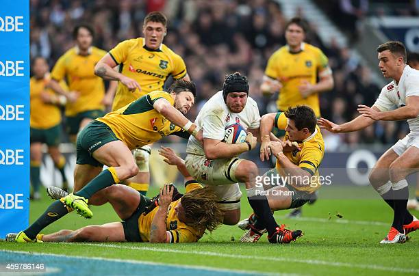 Ben Morgan of England barges over the tryline to score the opening try during the QBE international match between England and Australia at Twickenham...