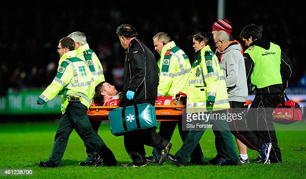 Ben Morgan of Gloucester is stretchered off with an injury during the Aviva Premiership match between Gloucester Rugby and Saracens at Kingsholm...