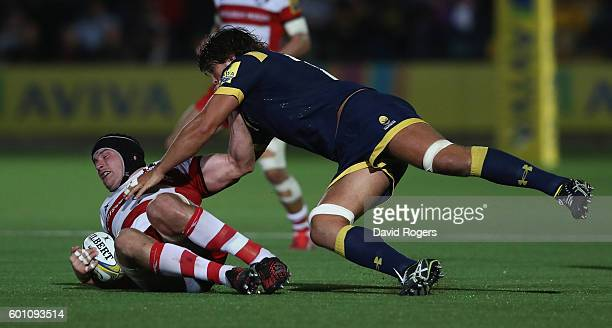 Ben Morgan of Gloucester is tackled by Donncha O'Callaghan during the Aviva Premiership match between Worcester Warriors and Gloucester at Sixways...