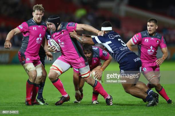 Ben Morgan of Gloucester powers past Kamaliele Tufele of Agen during the European Rugby Challenge Cup Pool 3 match between Gloucester and Agen at...