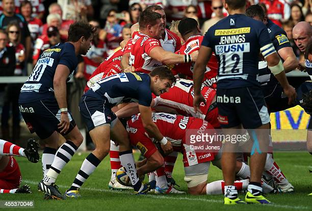 Ben Morgan of Gloucester Rugby touches down for a try as his pack drive the Sale Sharks scrum over the try line during the Aviva Premiership match...