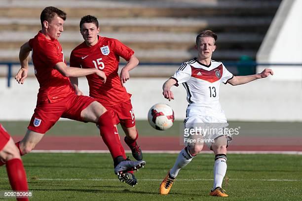 Ben Morris and Elliot Embleton of England challenge JanNiklas Beste of Germany during the UEFA Under17 match between U17 England v U17 Germany on...