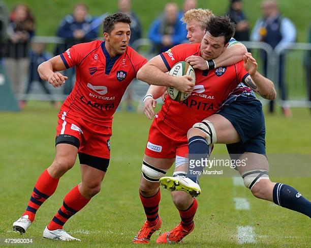 Ben Morris of Rotherham Titans tackles Glen Townson of Bristol during the Greene King IPA Championship Playoff SemiFinal match between Rotherham...