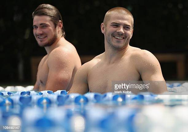 Ben Mowen and Drew Mitchell share a laugh during a pool recovery session at a Waratahs Super Rugby training session at at the members pool at the...