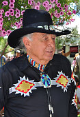 Ben Nighthorse Campbell a former US senator representing Colorado talks with other visitors at the annual Santa Fe Indian Market in Santa Fe New...