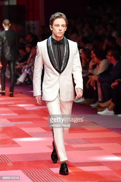 Ben Nordberg walks the runway at the Dolce Gabbana show during Milan Men's Fashion Week Spring/Summer 2018 on June 17 2017 in Milan Italy