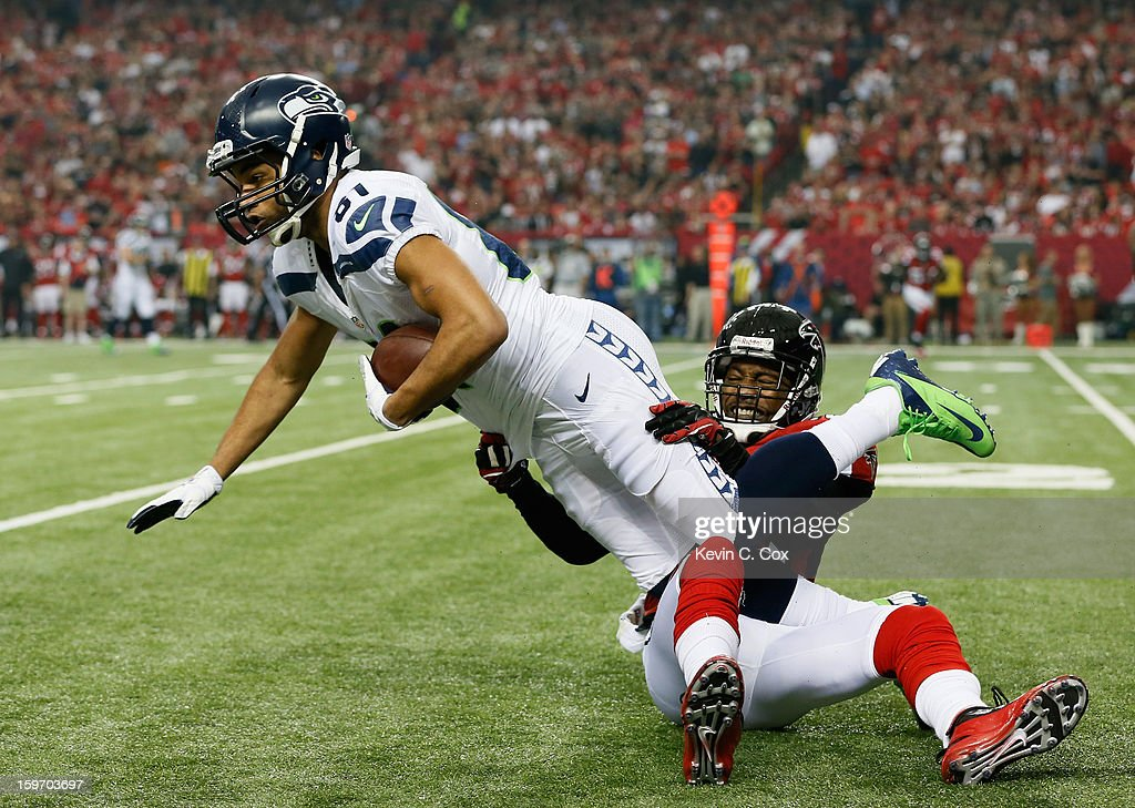 Ben Obomanu #87 of the Seattle Seahawks catches a pass against the defense of Dunta Robinson #23 of the Atlanta Falcons during the NFC Divisional Playoff Game at Georgia Dome on January 13, 2013 in Atlanta, Georgia.