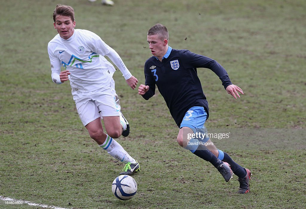 Ben O'Hanlan of England moves away from Luka Gajic during the UEFA European Under 17 Championship match between England and Slovenia at Pirelli Stadium on March 28, 2013 in Burton-upon-Trent, England.
