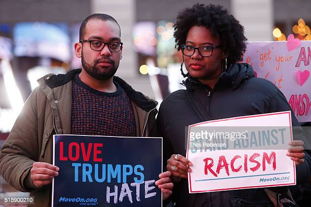 Ben O'Keefe of MoveOnorg and member of MoveOnorg Political Action stand outside the studios of 'Good Morning America' to broadcast messages of love...