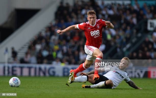 Ben Osborn of Nottingham Forest and Johnny Russell of Derby in action during the Sky Bet Championship match between Derby County and Nottingham...