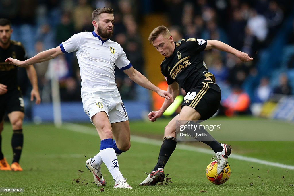 Ben Osborn of Nottingham Forest FC under pressure from Stuart Dallas of Leeds United FC during the Sky Bet Championship match between Leeds United and Nottingham Forest on February 6, 2016 in Leeds, United Kingdom.
