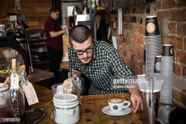 Ben Parenteau a barista at Great Lakes Coffee Roasting Company prepares a latte on September 6 2013 in Detroit Michigan Great Lakes Coffee Roasting...