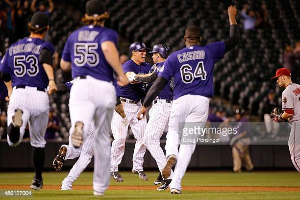 Ben Paulsen of the Colorado Rockies celebrates his game winning walk off two RBI single off of Matt Reynolds of the Arizona Diamondbacks with Nick...