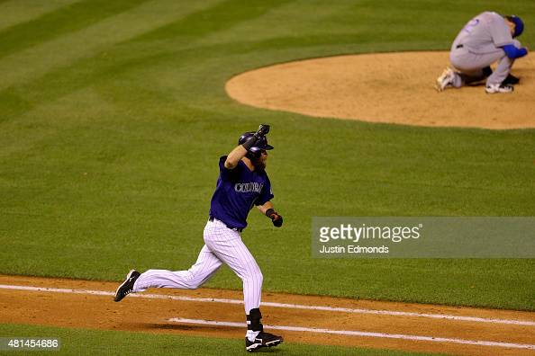 Ben Paulsen of the Colorado Rockies celebrates his walkoff RBI single off of relief pitcher Tanner Scheppers of the Texas Rangers in the ninth inning...