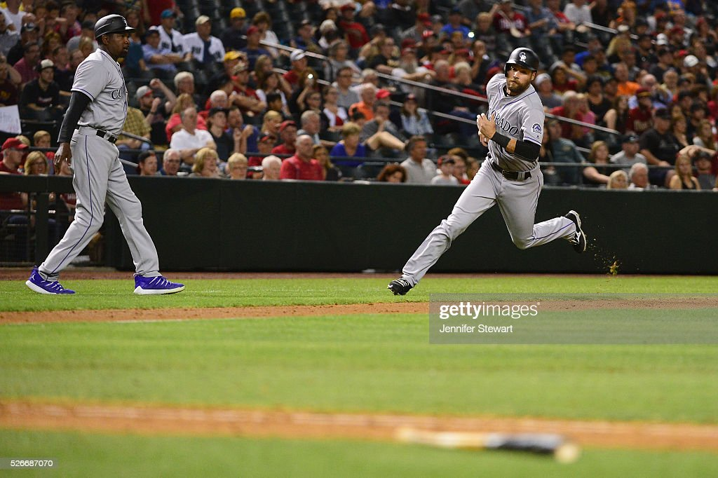 Ben Paulsen #10 of the Colorado Rockies rounds third bases to score in the ninth inning against the Arizona Diamondbacks at Chase Field on April 30, 2016 in Phoenix, Arizona.