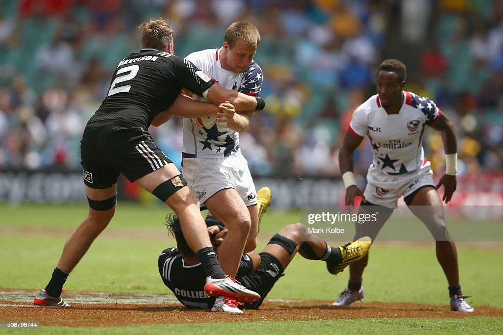 Ben Pinkleman of the United States of America is tackled during the 2016 Sydney Sevens cup quarter final match between New Zealand and the United States of America at Allianz Stadium on February 7, 2016 in Sydney, Australia.