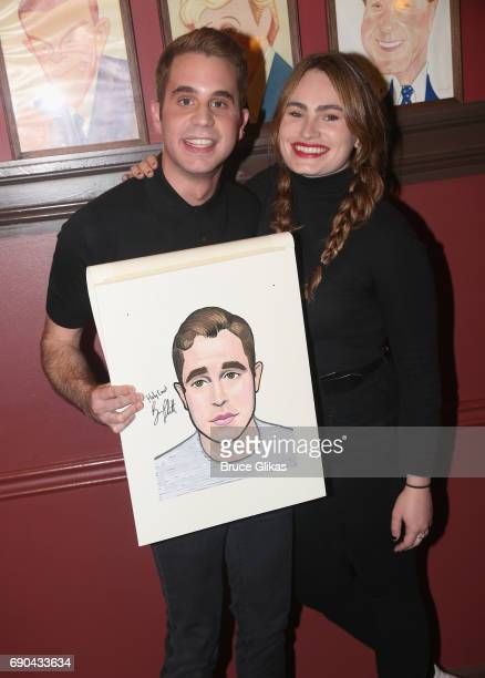Ben Platt and Kathryn Gallagher pose as Ben Platt gets honored for his performance in his broadway show 'Dear Evan Hansen' wth a caricature on the...