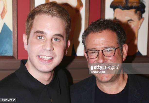 Ben Platt and Michael Greif pose as Ben Platt gets honored for his performance in his broadway show 'Dear Evan Hansen' wth a caricature on the wall...