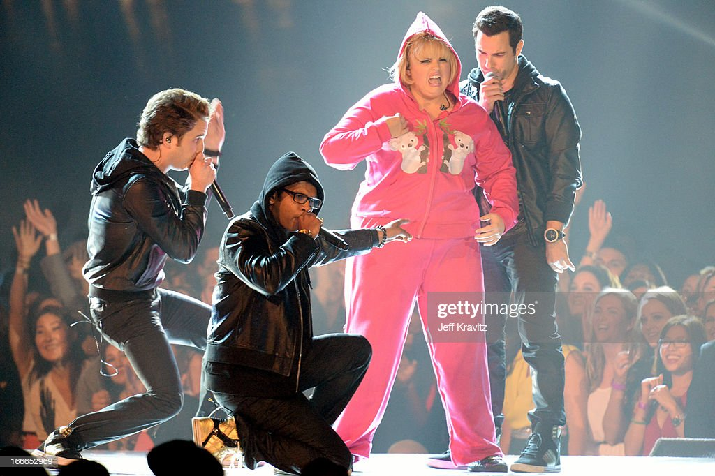 Ben Platt, Utkarsh Ambudkar, Rebel Wilson, and Skylar Astin perform onstage during the 2013 MTV Movie Awards at Sony Pictures Studios on April 14, 2013 in Culver City, California.