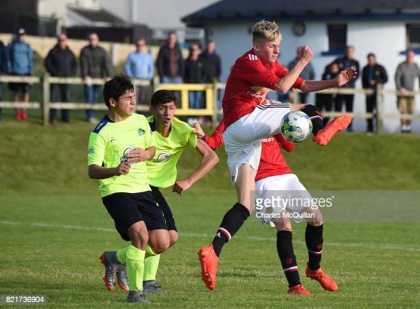 Ben Pleavin of Manchester United and Benjamin Reyes of Colina during the NI Super Cup junior section game between Manchester United and Colina at...
