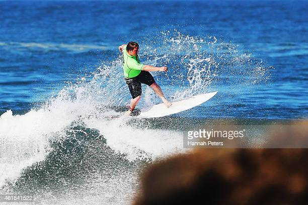 Ben Poulter of Raglan competes in the Open Men's Quarter Finals during the New Zealand Surf Nationals at Piha Beach on January 15 2015 in Auckland...