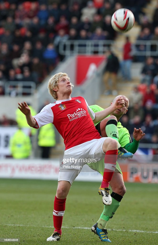 Ben Pringle (L) of Rotherham United contests the ball with Luke Guttridge of Northampton Town during the npower League Two match between Rotherham United and Northampton Town at New York Stadium on February 2, 2013 in Rotherham, England.