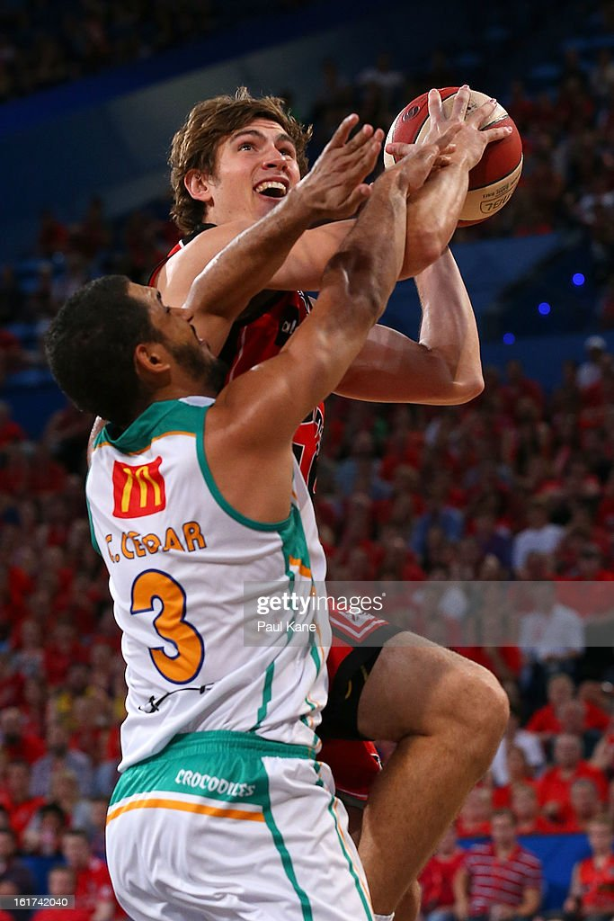 Ben Purser of the Wildcats drives to the basket against Chris Cedar of the Crocodiles during the round 19 NBL match between the Perth Wildcats and the Townsville Crocodiles at Perth Arena on February 15, 2013 in Perth, Australia.