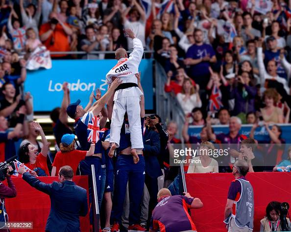 Ben Quilter of Great Britain is raised high in the air by his team mates to celebrate his u60kgs bronze medal victory during Day 1 of the London 2012...