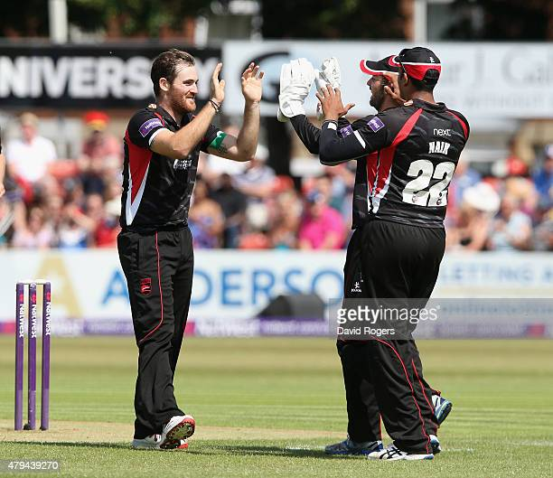 Ben Raine of Leicestershire Foxes celebrates with team mates after taking the wicket of Tom Lewis during the Natwest T20 Blast match between...