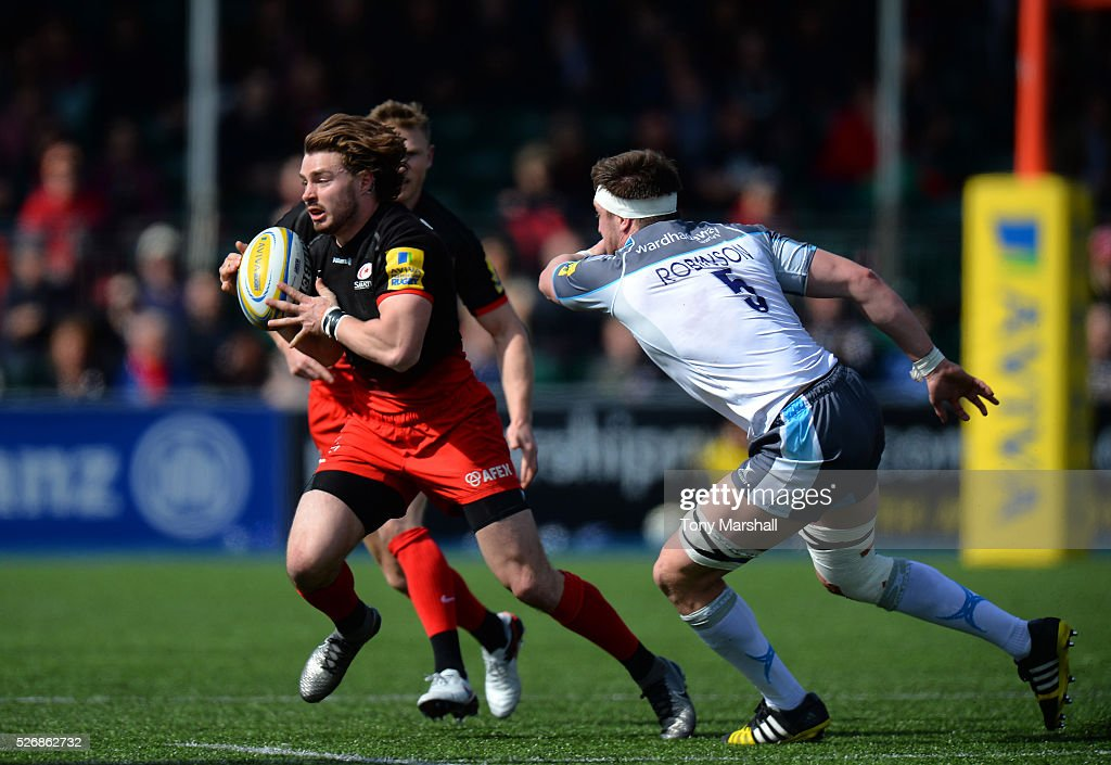 Ben Ransom of Saracens escapes from a tackle by Sean Robinson of Newcastle Falcons during the Aviva Premiership match between Saracens and Newcastle Falcons at Allianz Park on May 1, 2016 in Barnet, England.