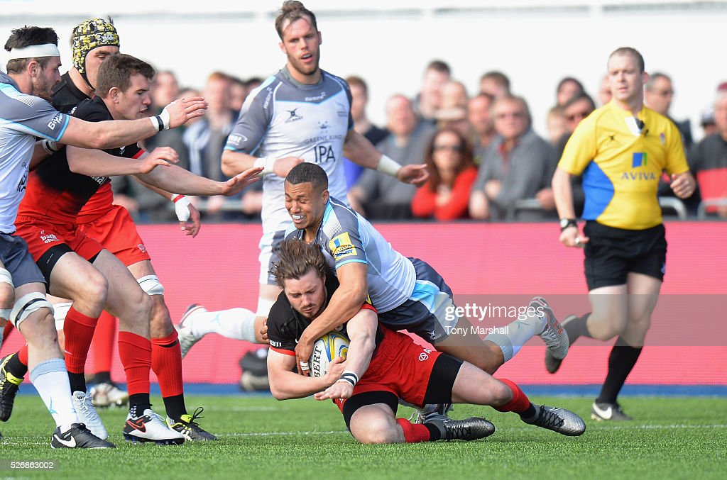Ben Ransom of Saracens is tackled by Marcus Watson of Newcastle Falcons during the Aviva Premiership match between Saracens and Newcastle Falcons at Allianz Park on May 1, 2016 in Barnet, England.